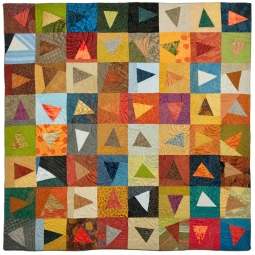 Color Study I: Flying Triangles (2012). Recycled garment silks. Designed & Pieced by Tierney Davis Hogan; quilted by Betty Anne Guadalupe. Photography by Jeremy Koons.